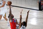 Oklahoma City Thunder's Steven Adams (12) shoots over Utah Jazz's Tony Bradley (13) during the first half of an NBA basketball game Saturday, Aug. 1, 2020, in Lake Buena Vista, Fla. (AP Photo/Ashley Landis, Pool)