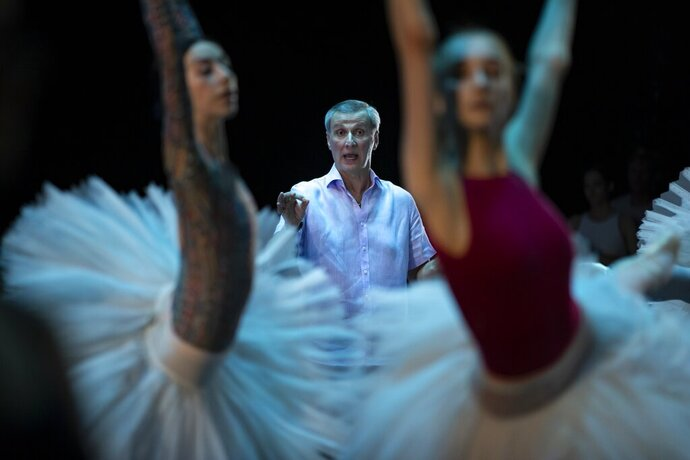 In this photo taken on Tuesday, June 11, 2019, The ballet director of the Bolshoi Theater Makhar Vaziev gestures as he conducts a rehearsal in the Bolshoi Theater in Moscow, Russia. Bolshoi Ballet's director Makhar Vaziev believes that Russian ballet must stay firmly rooted in what it does best, performing the classics, but also needs to breathe new life into them. (AP Photo/Alexander Zemlianichenko)