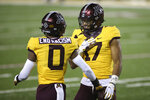 Minnesota wide receiver Seth Green (17) smiles at wide receiver Rashod Bateman (0) after Green scored a touchdown during the first half of the team's NCAA college football game against Purdue, Friday, Nov. 20, 2020, in Minneapolis. (AP Photo/Stacy Bengs)