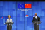 European Council President Charles Michel, right, and European Commission President Ursula von der Leyen attend a press conference following an EU-China virtual summit at the European Council building in Brussels, Monday, Sept. 14, 2020. Michel and Von der Leyen had talks in a videoconference with China's President Xi Jinping and German Chancellor Angela Merkel. (Yves Herman, Pool Photo via AP)
