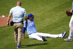 A trainer comes to the aid of Kansas City Royals pitcher Carlos Hernandez (71) after he was hit by a line drive during the sixth inning of a baseball game against the Chicago White Sox at Kauffman Stadium in Kansas City, Mo., Sunday, Sept. 6, 2020.(AP Photo/Orlin Wagner)