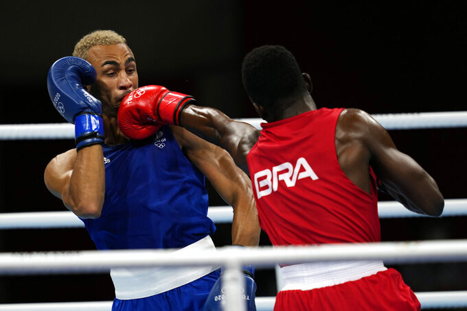 Keno Machado, of Brazil, right, punches Benjamin Whittaker, of Great Britain, during their light heavy weight 81kg quarterfinal boxing match at the 2020 Summer Olympics, Friday, July 30, 2021, in Tokyo, Japan. (AP Photo/Themba Hadebe)