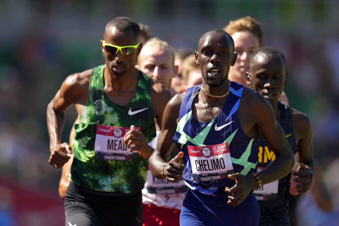 Winner, Paul Chelimo leads the pack in the finals of men's 5000-meter run at the U.S. Olympic Track and Field Trials Sunday, June 27, 2021, in Eugene, Ore. (AP Photo/Charlie Riedel)