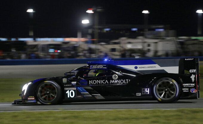Konica Minolta Cadillac DPi-V.R driver Renger van der Zande competes on the track during the Rolex 24-hour auto race at Daytona International Speedway, Saturday, Jan. 25, 2020, in Daytona Beach, Fla. (AP Photo/Terry Renna)