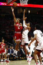 Indiana guard Romeo Langford, left, shoots over Maryland guard Aaron Wiggins in the first half of an NCAA college basketball game, Friday, Jan. 11, 2019, in College Park, Md. (AP Photo/Patrick Semansky)