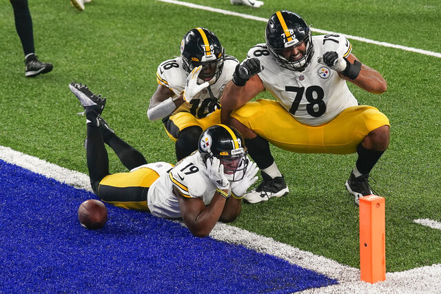 Pittsburgh Steelers wide receiver JuJu Smith-Schuster (19) offensive tackle Alejandro Villanueva (78) and wide receiver Diontae Johnson (18) celebrate after Smith-Schuster scored a touchdown against the New York Giants during the fourth quarter of an NFL football game Monday, Sept. 14, 2020, in East Rutherford, N.J. (AP Photo/Seth Wenig)