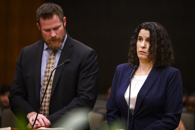Anti-vaccine activist Rebecca Dalelio, right, stands next to her attorney, Chet Templeton, as she is arraigned at the Sacramento Superior Courthouse on Monday, Jan. 13, 2020, in Sacramento, Calif. Dalelio, accused of throwing menstrual blood at legislators, was ordered by a judge to stay away from the state Capitol while awaiting trial. She did not enter a plea Monday and will return to Sacramento County Superior Court next month to face charges of vandalism and assault on public officials, The Sacramento Bee reported. (Daniel Kim/The Sacramento Bee via AP)