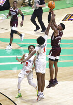 Mississippi State guard D.J. Stewart Jr. (3) hits the go-ahead shot as Richmond guard Jacob Gilyard (0) and guard Blake Francis (1) defend during the second half of an NCAA college basketball game in the semifinals of the NIT, Thursday, March 25, 2021, in Denton, Texas. (AP Photo/Ron Jenkins)