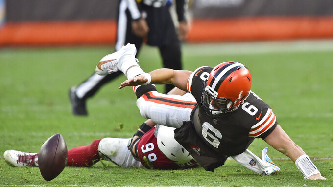 Cleveland Browns quarterback Baker Mayfield (6) fumbles and is injured on a play during the second half of an NFL football game against the Arizona Cardinals, Sunday, Oct. 17, 2021, in Cleveland. (AP Photo/David Richard)