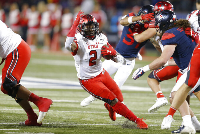 Utah running back Zack Moss (2) runs for a first down against Arizona during the first half of an NCAA college football game Saturday, Nov. 23, 2019, in Tucson, Ariz. (AP Photo/Rick Scuteri)