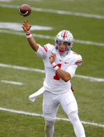 Ohio State quarterback Justin Fields throws a pass against Michigan State during the first half of an NCAA college football game, Saturday, Dec. 5, 2020, in East Lansing, Mich. (AP Photo/Al Goldis)