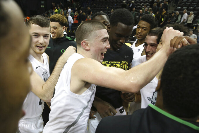 Oregon's Payton Pritchard, center, celebrates with his teammates after the team's win over Oregon State in an NCAA college basketball game in Eugene, Ore., Thursday, Feb. 27, 2020. (AP Photo/Chris Pietsch)