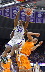 LSU guard Marlon Taylor (14) dunks the ball on a put back over Tennessee forward Grant Williams (2) in the first half of an NCAA college basketball game, Saturday, Feb. 23, 2019, in Baton Rouge, La. (AP Photo/Bill Feig)