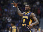 Murray State's Shaq Buchanan (11) gestures after making a basket during the first half of a first round men's college basketball game against Marquette in the NCAA Tournament, Thursday, March 21, 2019, in Hartford, Conn. (AP Photo/Elise Amendola)