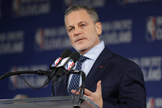 FILE - In this Nov. 1, 2018 file photo, Cavaliers owner and Quicken Loans founder and Chairman Dan Gilbert speaks at a news conference announcing the 2022 NBA All -Star game, in Cleveland. Gilbert is slowly returning to work eight months after suffering a stroke. The 58-year-old entrepreneur returned to his Detroit office early this year. In an interview with Crain's Detroit Business, he said he spends one or two days a week in his office, using a wheelchair and accompanied by a service dog. (AP Photo/Tony Dejak, File)