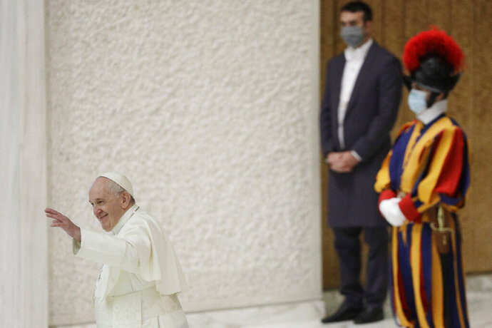 """Pope Francis waves at the end of his weekly general audience in the Paul VI hall at the Vatican, Wednesday, Oct. 21, 2020. Pope Francis endorsed same-sex civil unions for the first time as pope while being interviewed for the feature-length documentary """"Francesco,"""" which premiered Wednesday at the Rome Film Festival. (AP Photo/Gregorio Borgia)"""