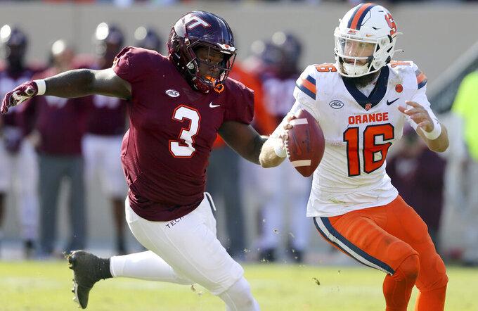 Virginia Tech defensive lineman Norell Pollard (3) chases Syracuse quarterback Garrett Shrader (16) during the second half of an NCAA college football game in Blacksburg Va., Saturday, Oct. 23 2021. (Matt Gentry/The Roanoke Times via AP)