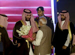 Saudi Arabia's Crown Prince Mohammed bin Salman, is received by Indian Prime Minister Narendra Modi,back to camera, at the airport in New Delhi, India, Tuesday, Feb.19, 2019. Prince Mohammed arrived in India after visiting Pakistan, which New Delhi blames for a suicide bombing attack last week that killed at least 40 Indian soldiers in disputed Kashmir. (AP Photo/Manish Swarup)