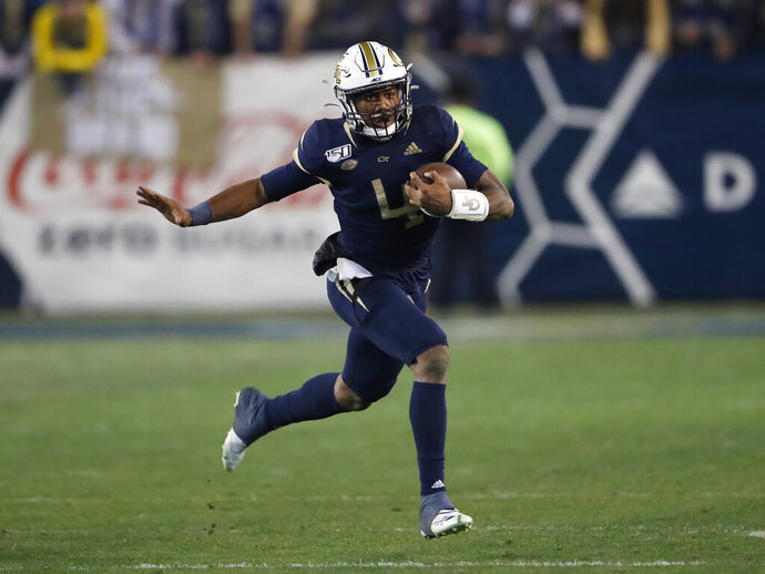 Georgia Tech quarterback James Graham runs during the second half of the team's NCAA college football game against North Carolina State on Thursday, Nov. 21, 2019, in Atlanta. Georgia Tech won 28-26. (AP Photo/John Bazemore)