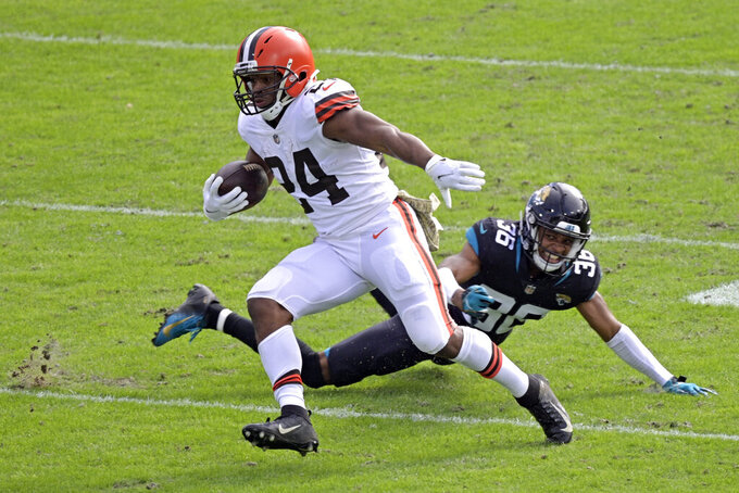 Cleveland Browns running back Nick Chubb (24) runs past Jacksonville Jaguars cornerback Luq Barcoo (36) for yardage during the first half of an NFL football game, Sunday, Nov. 29, 2020, in Jacksonville, Fla. (AP Photo/Phelan M. Ebenhack)