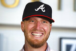 Atlanta Braves new left-handed pitcher Will Smith smiles during an introductory press conference at SunTrust Park in Atlanta, Tuesday, Nov. 19, 2019. (Curtis Compton/Atlanta Journal-Constitution via AP)