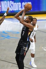 Brooklyn Nets' Kevin Durant (7) shoots over a defender during the first half of an NBA basketball game against the New Orleans Pelicans Wednesday, April 7, 2021, in New York. (AP Photo/Frank Franklin II)