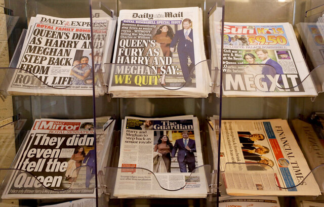 Newspapers are seen for sale in London, Thursday, Jan. 9, 2020. In a statement Prince Harry and his wife, Meghan, said they are planning