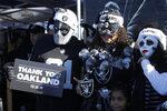 Oakland Raiders fans tailgate before the start of an NFL football game against the Jacksonville Jaguars in Oakland, Calif., Sunday, Dec. 15, 2019. The game is the final scheduled Raiders game in Oakland. (AP Photo/Ben Margot)
