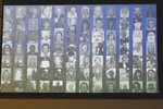The photos of the 84 people killed in a 2018 wildfire that wiped out the town of Paradise, are displayed during a hearing held on felony charges against PG&E Corp., in Butte County Superior Court in Chico, Calif., Tuesday, June 16, 2020. PG&E CEO Bill Johnson, entered guilty pleas on behalf of the company for 84 felony counts of involuntary manslaughter stemming from the fire which was blamed on the company's crumbling electrical grid. (AP Photo/Rich Pedroncelli, Pool)