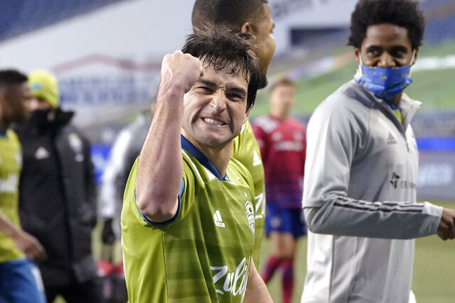 Seattle Sounders' Nicolas Lodeiro pumps his fist as he heads off the field after the team's 1-0 win over FC Dallas in an MLS playoff soccer match Tuesday, Dec. 1, 2020, in Seattle.  (AP Photo/Ted S. Warren)