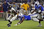 North Carolina A&T quarterback Kingsley Ifedi (12) runs against Duke defensive tackle Aeneas Peebles (92) and defensive end R.J. Oben (94) during the first half of an NCAA college football game in Durham, N.C., Friday, Sept. 10, 2021. (AP Photo/Chris Seward)