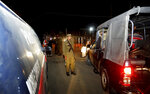 Pakistani police officers cordon off the area of a bomb blast in Raiwind near Lahore, Pakistan, Wednesday, March 14, 2018. A suspected suicide attack near a police checkpoint killed many and wounded others on Wednesday near the eastern city of Lahore, police said. (AP Photo/K.M. Chaudary)