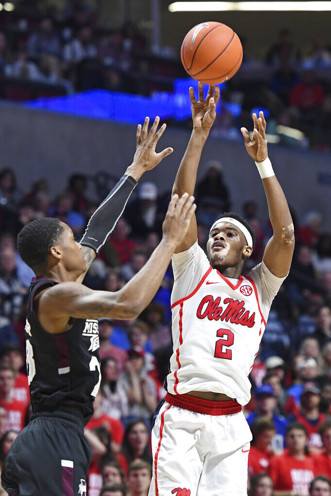 Mississippi guard Devontae Shuler (2) takes a shot over Mississippi State guard Tyson Carter (23) during the second half of an NCAA college basketball game in Oxford, Miss., Tuesday, Feb. 11, 2020. Mississippi won 83-58. (AP Photo/Thomas Graning)