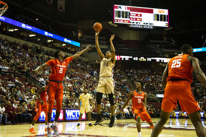 Florida State guard Devin Vassell (24) shoots against Clemson in the second half of an NCAA college basketball game in Tallahassee, Fla., Sunday, Dec. 8, 2019. Florida State defeated Clemson 72-53. (AP Photo/Mark Wallheiser)