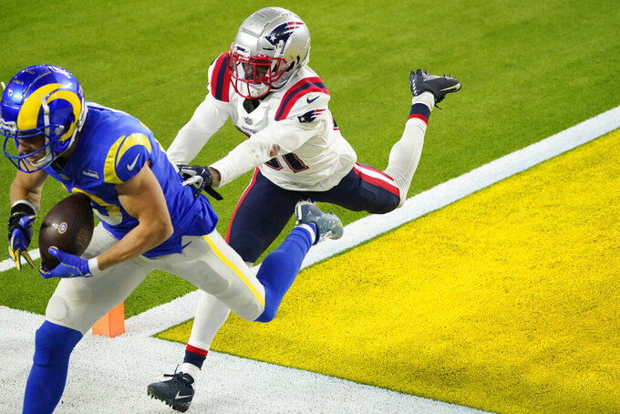 Los Angeles Rams wide receiver Cooper Kupp, left, catches a touchdown pass next to New England Patriots defensive back Jonathan Jones during the second half of an NFL football game Thursday, Dec. 10, 2020, in Inglewood, Calif. (AP Photo/Ashley Landis)