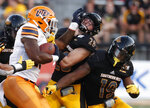 UTEP running back Treyvon Hughes (19) is tackled by Southern Mississippi linebacker Swayze Bozeman (28) and defensive back Ky'el Hemby (19) during the first half of their NCAA college football game in Hattiesburg, Miss., Saturday, Sept. 28, 2019. (AP Photo/Rogelio V. Solis)