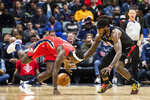 New Orleans Pelicans guard Jrue Holiday (11) dives for the ball in possession of Los Angeles Clippers forward Montrezl Harrell (5) in the second half of an NBA basketball game in New Orleans, Thursday, Nov. 14, 2019. (AP Photo/Sophia Germer)