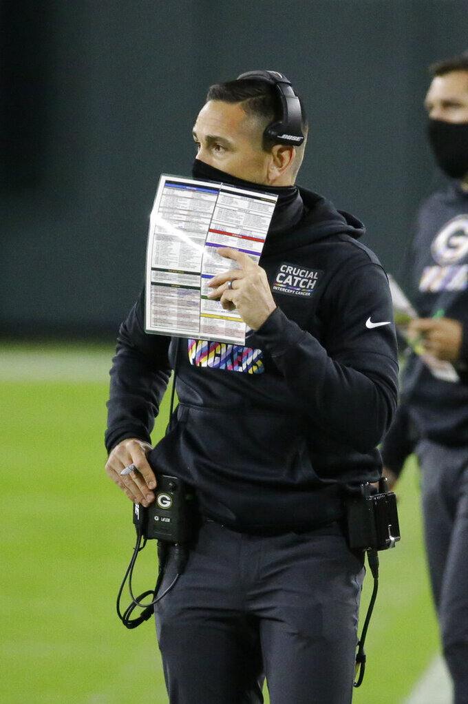 Green Bay Packers head coach Matt LaFleur watches the first half of an NFL football game against the Atlanta Falcons, Monday, Oct. 5, 2020, in Green Bay, Wis. (AP Photo/Mike Roemer)