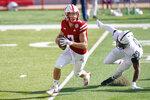 Nebraska quarterback Luke McCaffrey (7) is pursued by Penn State defensive end Jayson Oweh (28) during the first half of an NCAA college football game in Lincoln, Neb., Saturday, Nov. 14, 2020. (AP Photo/Nati Harnik)
