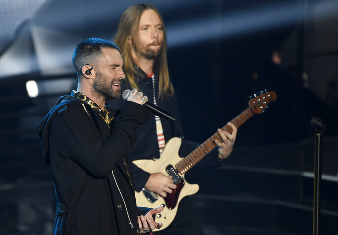 "FILE - In this Sunday, March 11, 2018 file photo, Adam Levine, left, and James Valentine of Maroon 5 perform during the 2018 iHeartRadio Music Awards at The Forum in Inglewood, Calif. Maroon 5 has canceled its news conference to discuss the band's Super Bowl halftime performance, choosing to not meet with reporters as most acts have done during the week leading up to the NFL's big game. The NFL announced Tuesday, Jan. 29, 2019 that ""the artists will let their show do the talking as they prepare to take the stage this Sunday."" (Photo by Chris Pizzello/Invision/AP, File)"
