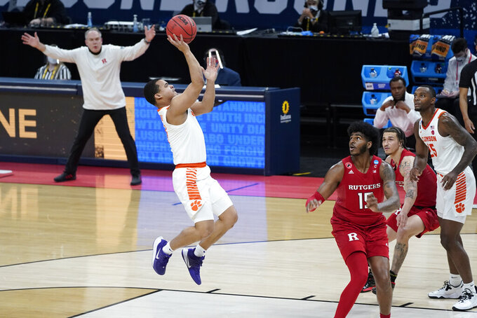 Clemson guard Nick Honor (4) shoots against Rutgers during the first half of a men's college basketball game in the first round of the NCAA tournament at Bankers Life Fieldhouse in Indianapolis, Friday, March 19, 2021. (AP Photo/Paul Sancya)