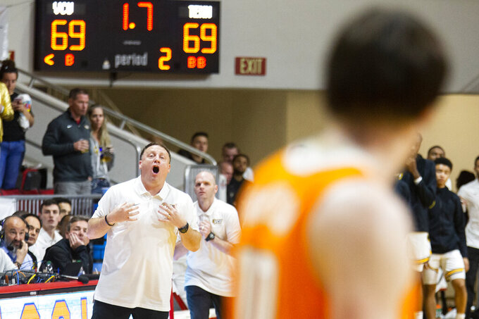 Virginia Commonwealth head coach Mike Rhoades shouts instructions before Tennessee's final shot with 1.7 seconds in the second half of an NCAA college basketball game at the Emerald Coast Classic in Niceville, Fla., Saturday, Nov. 30, 2019. Tennessee defeated Virginia Commonwealth 72-69. (AP Photo/Mark Wallheiser)