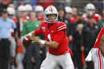 Ohio State quarterback Justin Fields drops back to pass against Wisconsin during the first half of an NCAA college football game Saturday, Oct. 26, 2019, in Columbus, Ohio. (AP Photo/Jay LaPrete)
