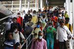 Passengers crowd a railway station in Ahmedabad, India, Friday, July 23, 2021. (AP Photo/Ajit Solanki)