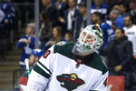 Minnesota Wild goaltender Devan Dubnyk reacts after a Toronto Maple Leafs goal during the second period of an NHL hockey game Tuesday, Oct. 15, 2019, in Toronto. (Chris Young/The Canadian Press via AP)
