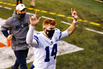 Dallas Cowboys quarterback Andy Dalton (14) runs off the field following an NFL football game against the Cincinnati Bengals in Cincinnati, Sunday, Dec. 13, 2020. The Cowboys defeated the Bengals 30-7. (AP Photo/Aaron Doster)