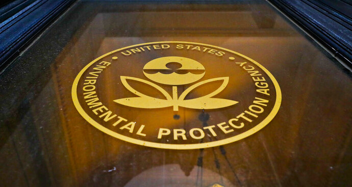 FILE - In this Sept. 21, 2017, file photo, a sign on a door of the Environmental Protection Agency in Washington. Government figures show the EPA has hit a 30-year low in the number of pollution cases referred for criminal prosecution. Justice Department data released Tuesday, Jan. 15, 2019, by the Public Employees for Environmental Responsibility show the EPA referred 166 cases for federal prosecution in fiscal year 2018.(AP Photo/Pablo Martinez Monsivais, File)