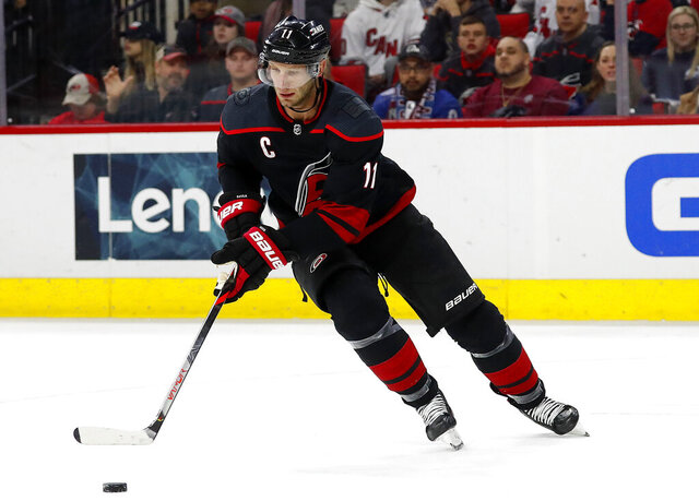 FILE - In this Feb. 28, 2020, file photo, Carolina Hurricanes' Jordan Staal (11) controls the puck against the Colorado Avalanche during the first period of an NHL hockey game in Raleigh, N.C. Staal helped the Hurricanes reach the Eastern Conference finals in 2019 and return to the playoffs in 2020. (AP Photo/Karl B DeBlaker, File)