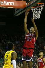Arizona forward Zeke Nnaji (22) scores in front of Baylor guard Devonte Bandoo (2) during the first half of an NCAA college basketball game in Waco, Texas, Saturday, Dec. 7, 2019. (AP Photo/Michael Ainsworth)
