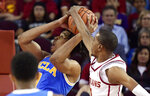 Southern California guard Shaqquan Aaron, right, blocks the shot of UCLA center Moses Brown during the first half of an NCAA college basketball game Saturday, Jan. 19, 2019, in Los Angeles. (AP Photo/Mark J. Terrill)